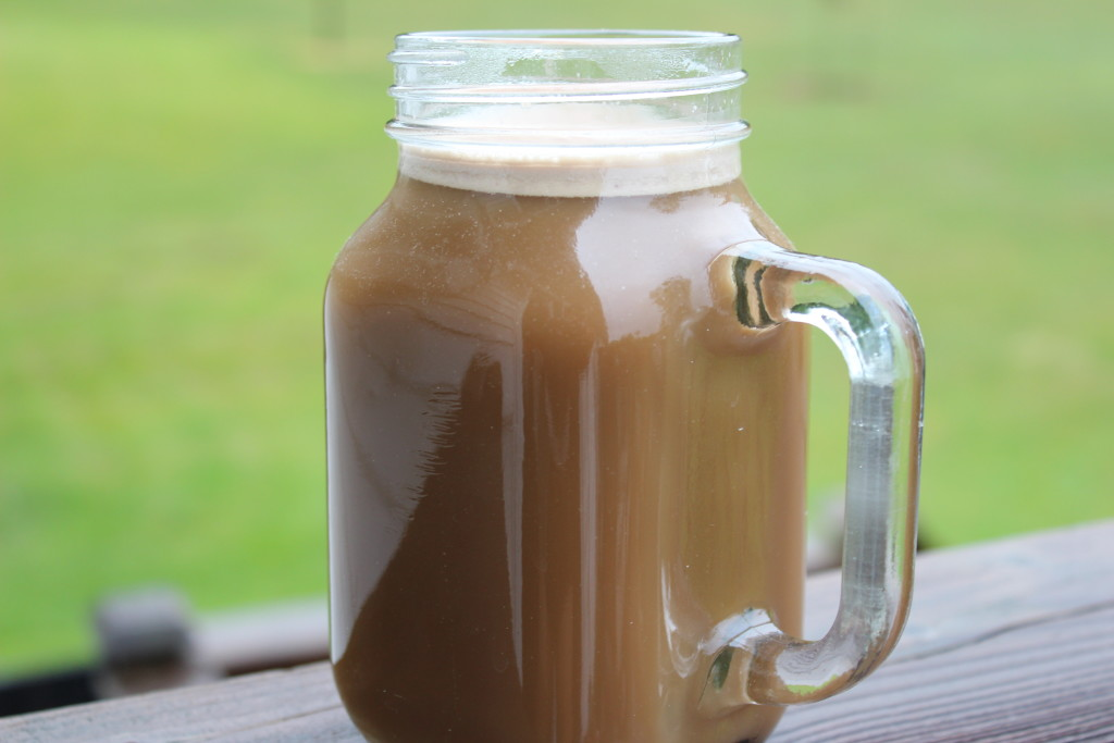 mason jar mug with Protein Coffee Recipe in it on a deck; (dairy free) protein packed morning drink to kick start your day right!