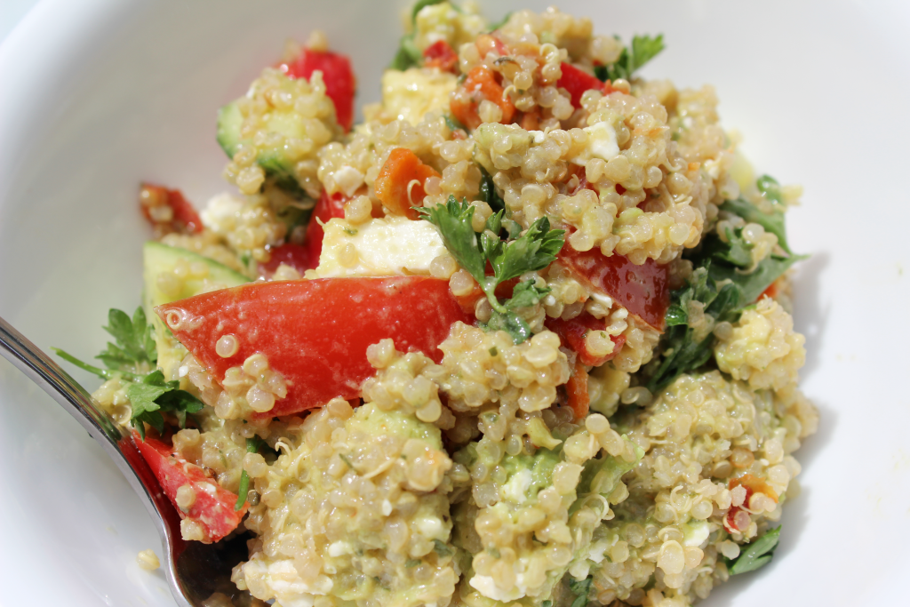 Avocado Greek Quinoa Salad with Lemon Dijon Dressing. Tomatoes, cucumber, parsley and red pepper.