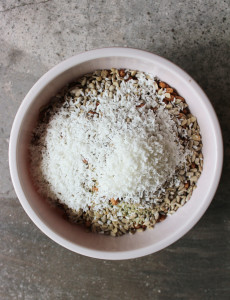Energy bar ingredients in a bowl, topped with coconut