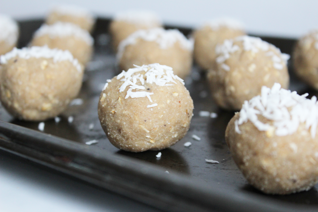 Beige coloured Apple Pie Protein balls with shredded coconut on top - gluten free and vegan