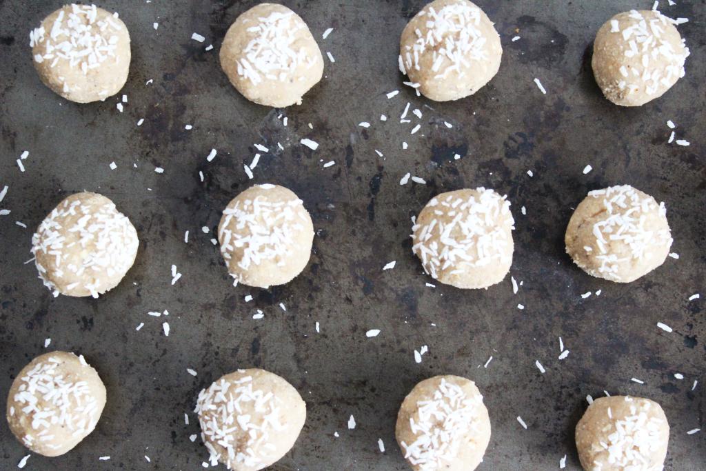 Round apple pie protein balls on a baking sheet