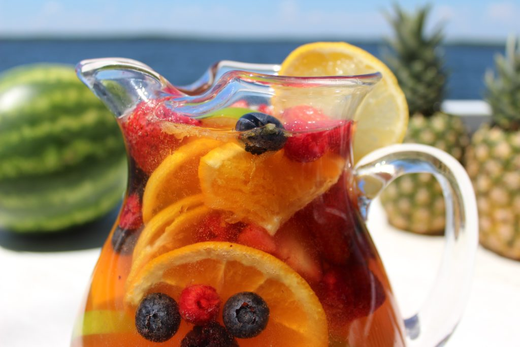 Jungle juice sangria recipe is light and refreshing, packed with fresh fruit like strawberries, oranges, blueberries, and more!
