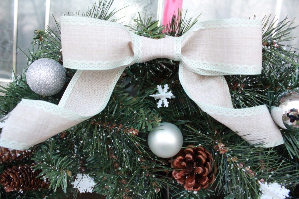 The theme of this DIY Christmas Wreath is white and silver to match my other Christmas decor