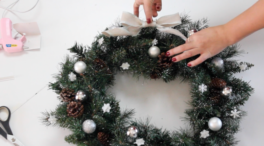 All you need to make this DIY Christmas Wreath is some Christmas ornaments and other accessories like ribbon and pinecones.