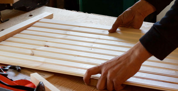 Measure then cut the wood board you'll use for your backdrop