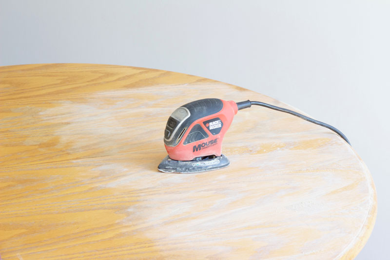 Sanding down the original finish of the dining room table