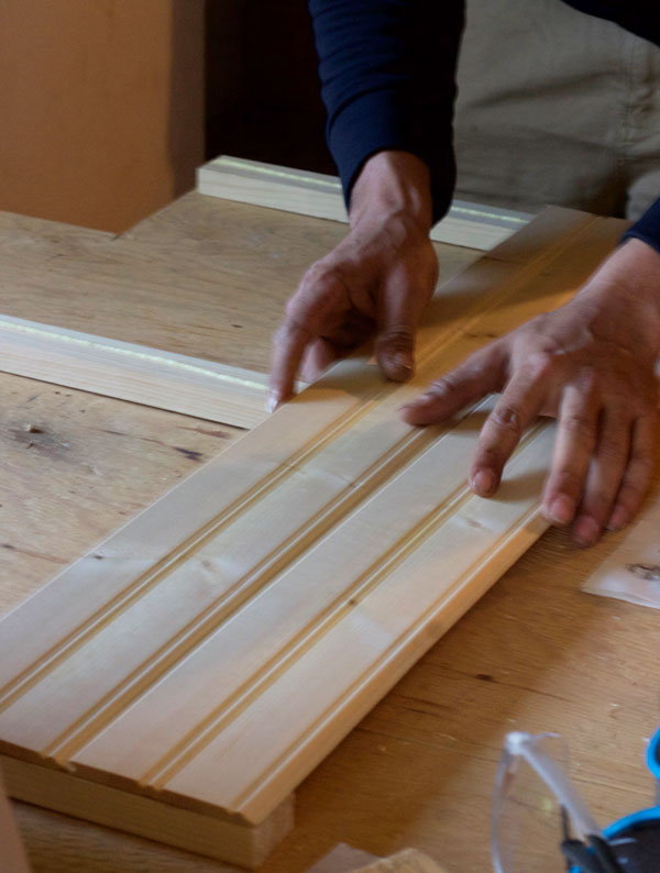 Line the wood strips up on the glued pine boards