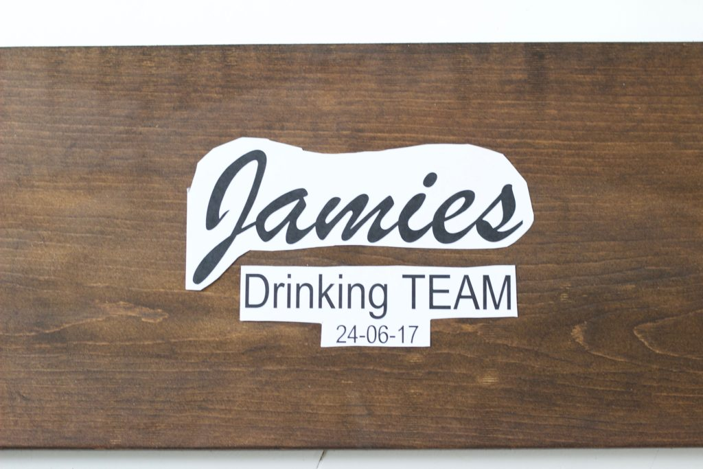 "DIY Personalized ""Bride's Drinking Team"" Sign! Get everyone to sign it at the bachelorette party and then give it to her as a keep sake! - www.nikkisplate.com"