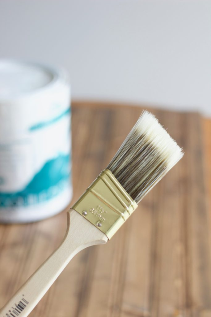 I used this small paintbrush to apply the first light layer of white paint to my stained wood