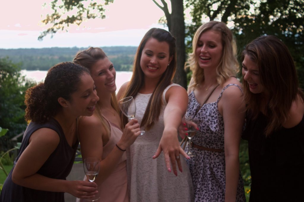 Nikki and her close girl friends gather to admire Nikki's new engagement ring