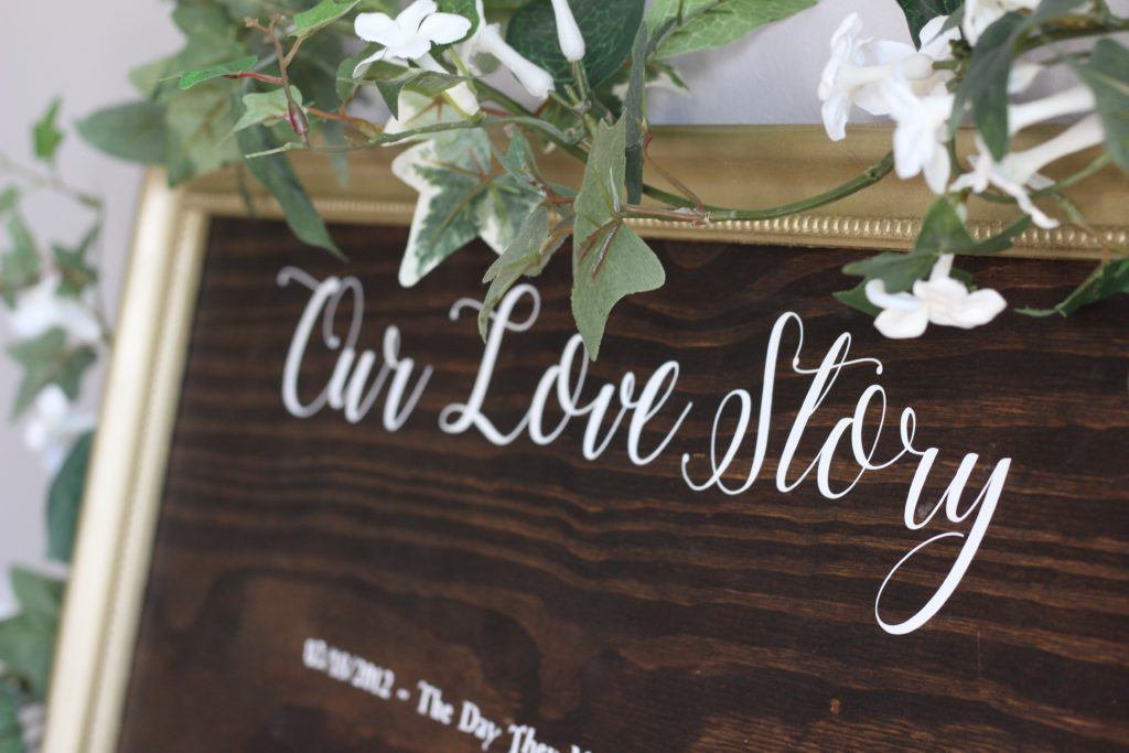 Our DIY Our Love Story sign I made for our wedding