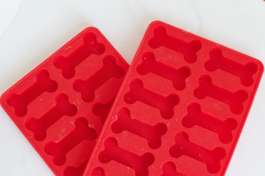 Use silicone dog treat molds to make these delicious peanut butter and pumpkin dog treats