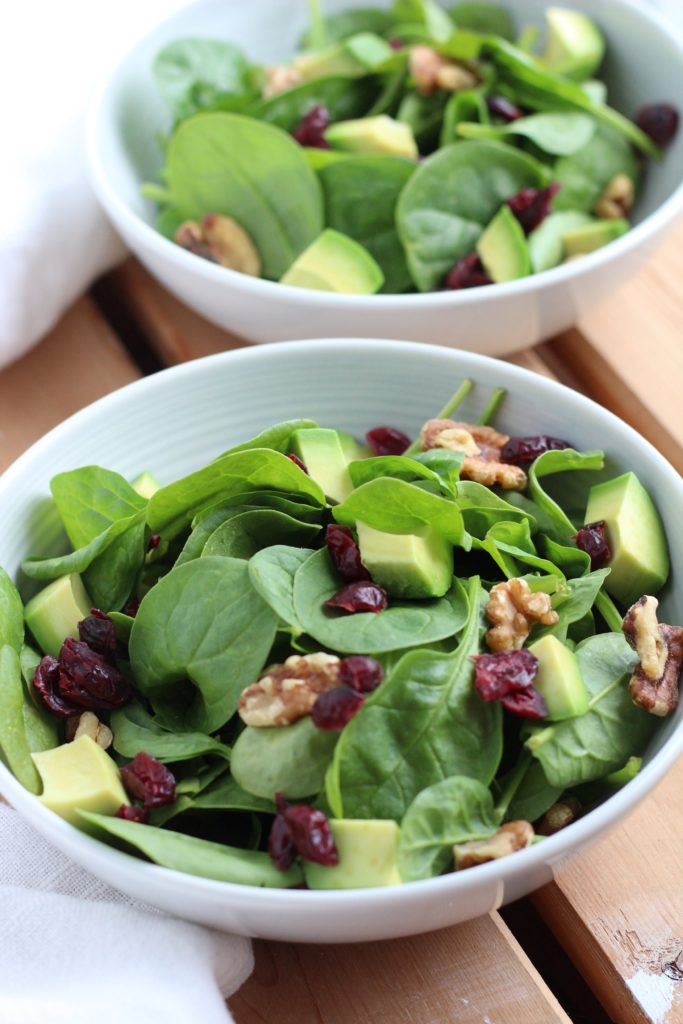 Make this delicious cranberry walnut salad for lunch and top it with a homemade honey ginger dressing