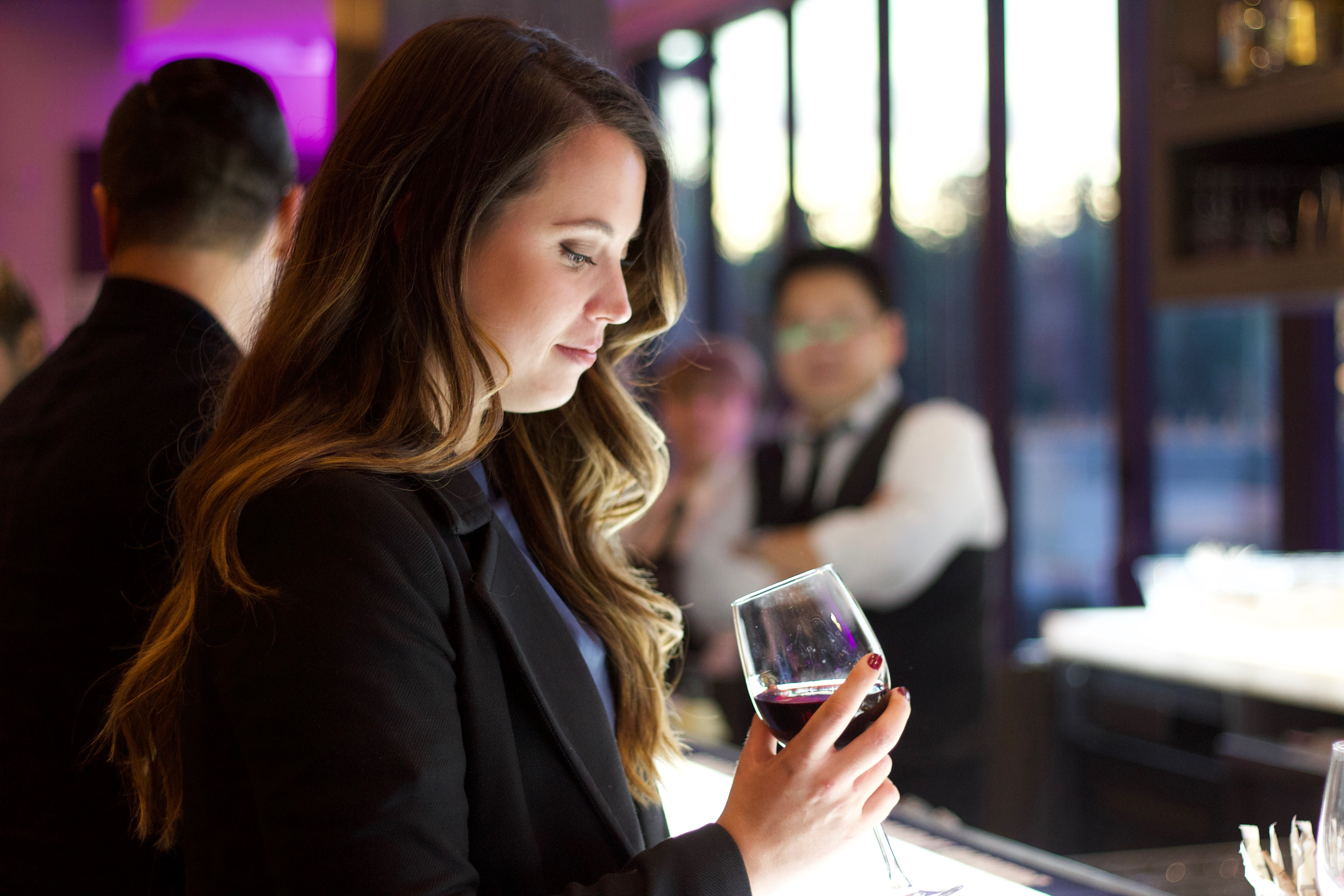 Nikki enjoying a glass of red wine at the Chateau Le Parc Vineyard food blogger event.