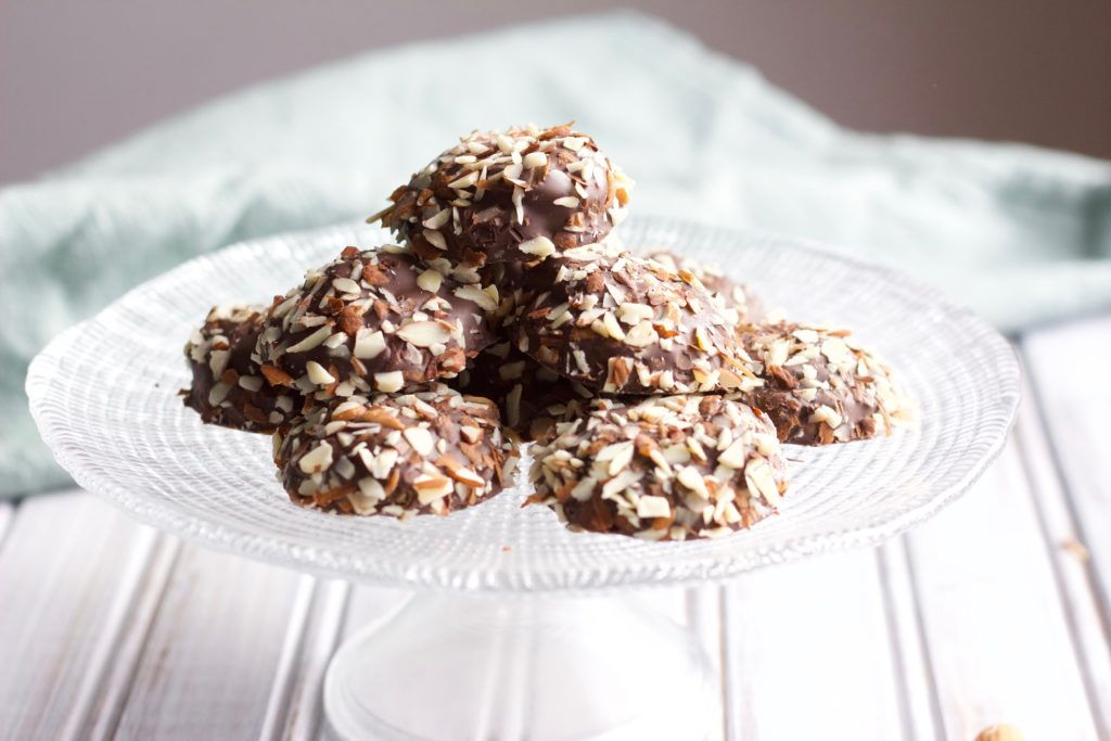 Soft and chewy chocolate cookies are dipped in creamy chocolate and coated with chopped chestnut pieces