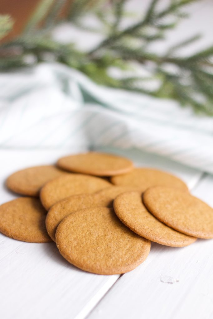 Gluten Free Chocolate Dipped Gingersnaps || Pile of round golden gingersnaps, Christmas baking, cookies.|| Nikki's Plate by Nikki Bahan