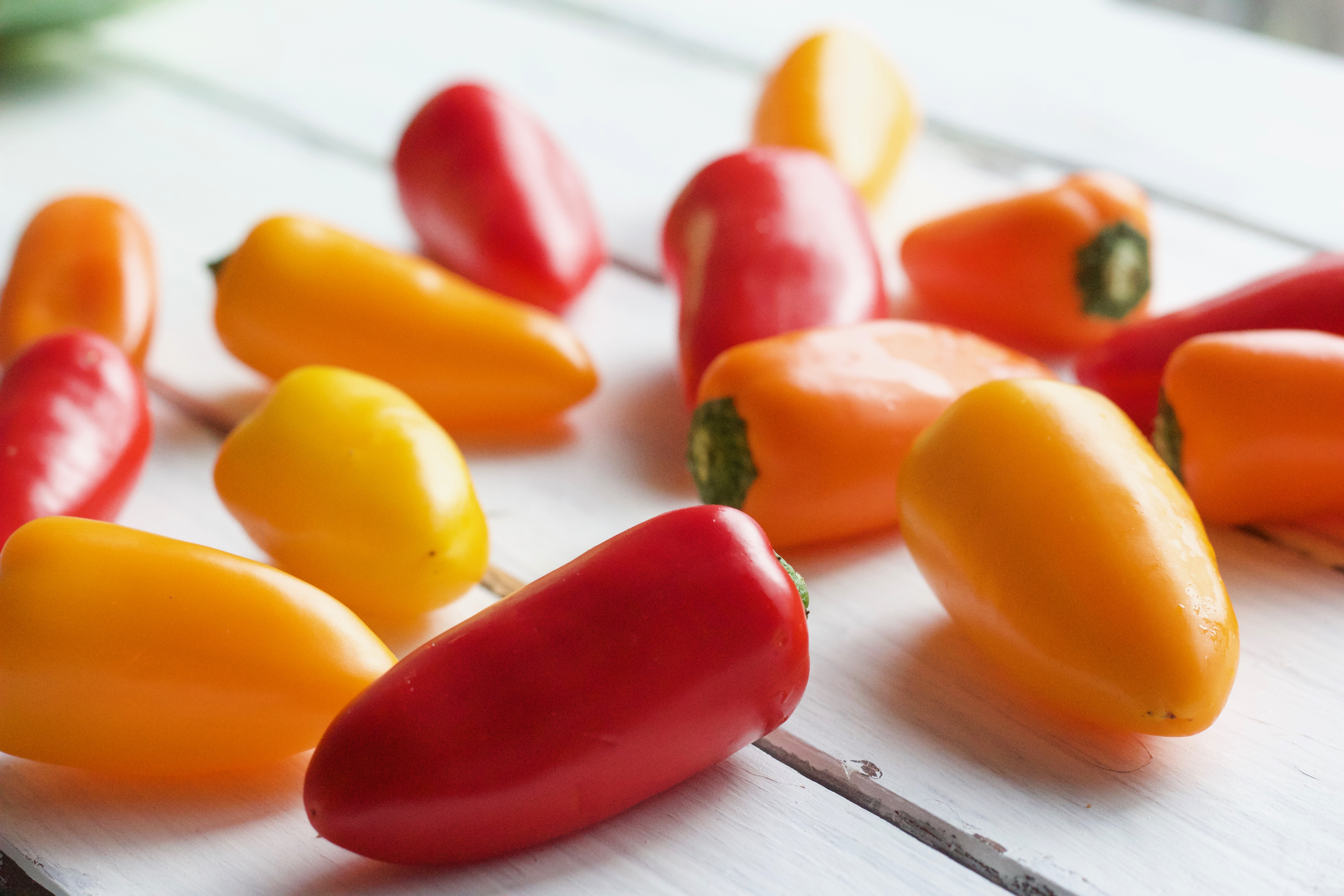 Photo of orange, yellow and red Tribelli Peppers for this creamy cauliflower bake recipe