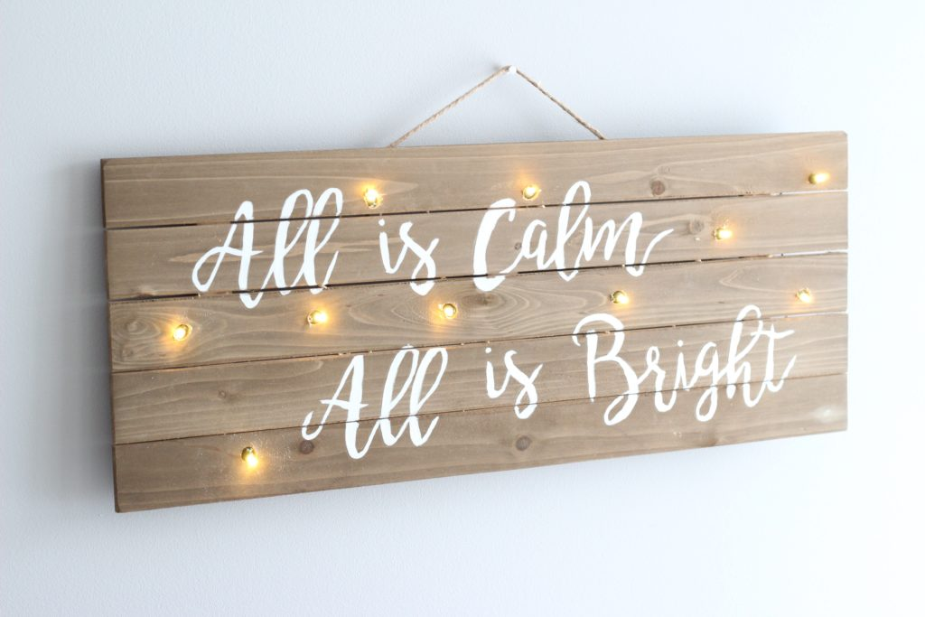 This Christmas lights sign is an easy DIY that makes a perfect homemade Christmas gift.