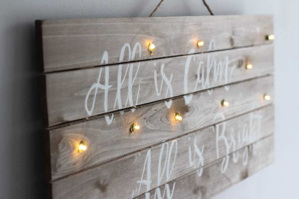 This DIY Christmas lights wood sign is an easy DIY that's perfect for the Holidays
