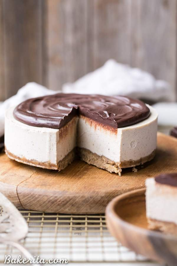 THis no-bake vegan vanilla bean cheesecake is topped with a dairy-free chocolate ganache that's rich and creamy.