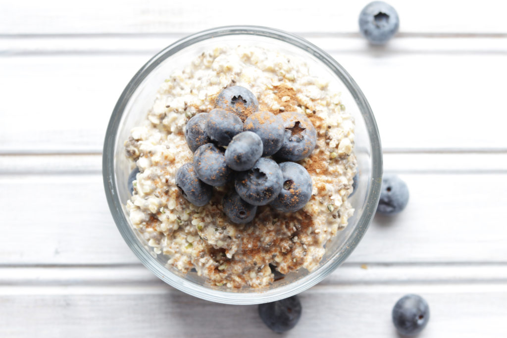 Creamy vanilla blueberry overnight oats topped with a sprinkle of cinnamon