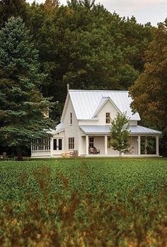 I love the farmhouse style cottage look of this home exterior!