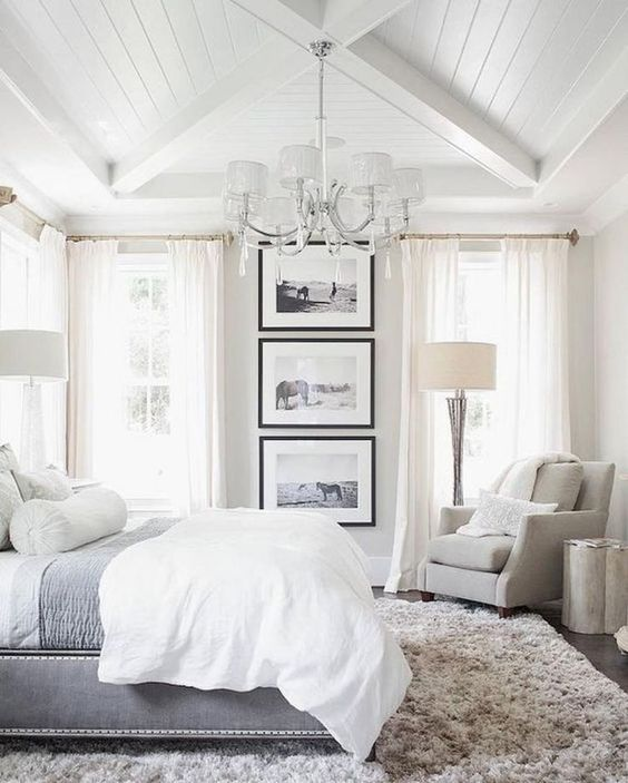 This grand master bedroom feels like it's a 5-star hotel room in your own home. I love the large framed pictures!