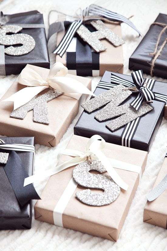 Classic black, white, and brown gift wrap with sparkling glitter letters for the perfect touch of personalization