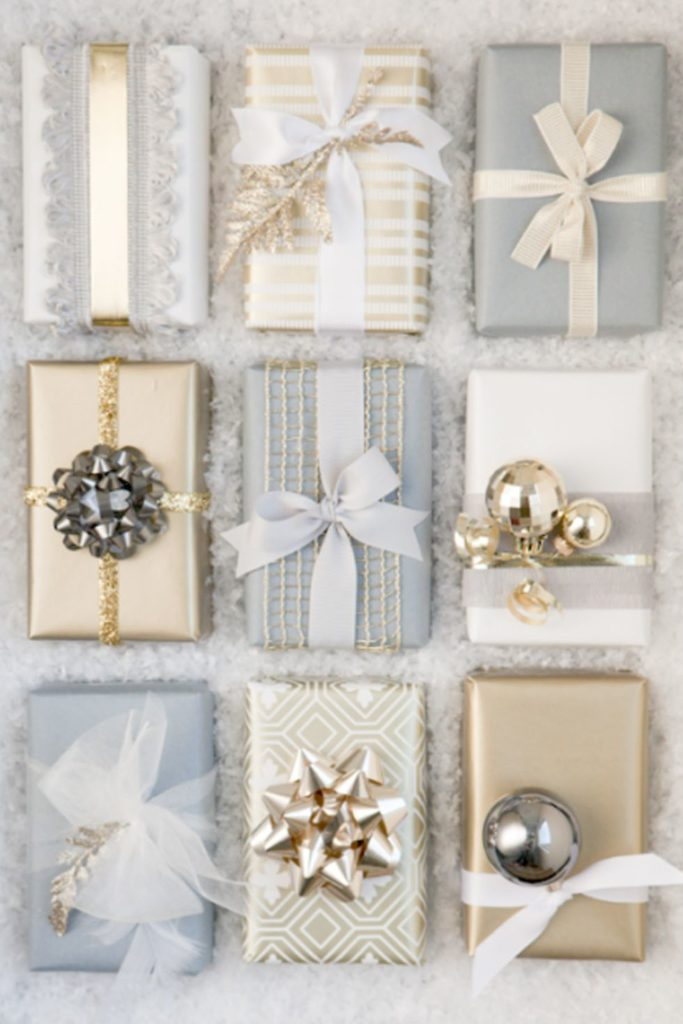 This gift wrapping is elegant and classy, but the golf and silver ribbons, bows, and bells as such a fancy touch