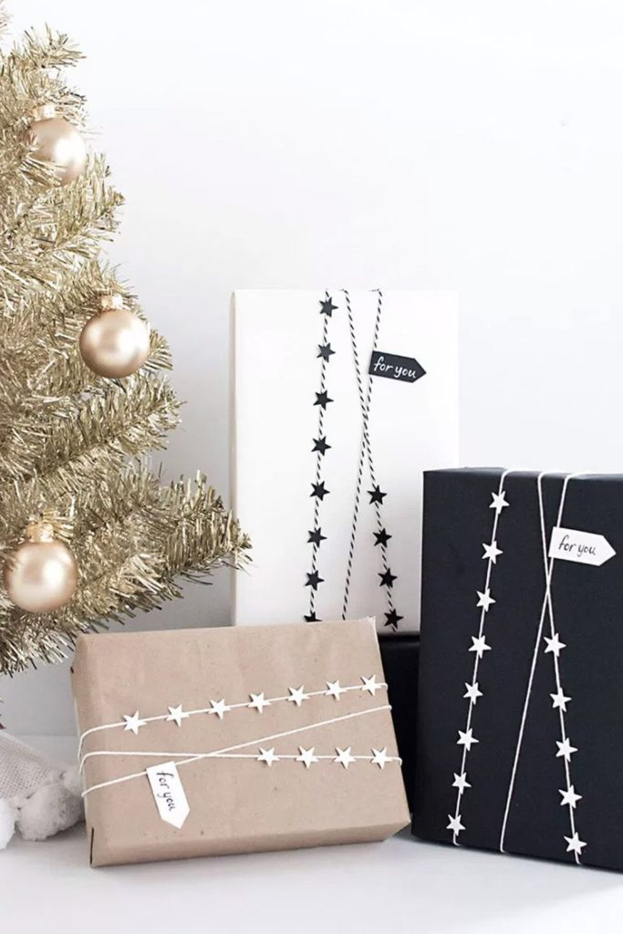 This gift wrap is simple with black, white, and brown wrapping, accented with sparkling black and white star rope