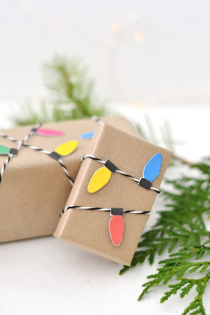 This gift wrap is simple brown paper, but the christmas lights add a nice, festive touch