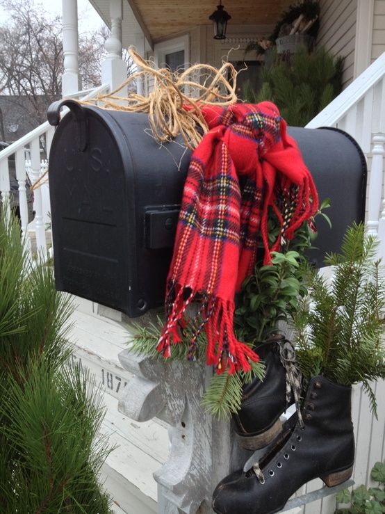 This Christmas mailbox is decked out with a festive red plaid scarf and some ice stakes!