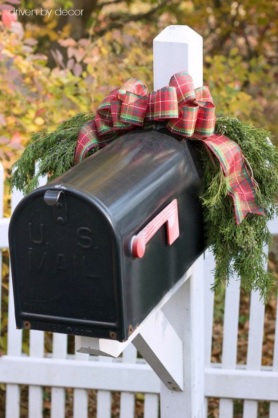 This Christmas mailbox is simply decorated with some plaid ribbon and fresh balsam tree branches