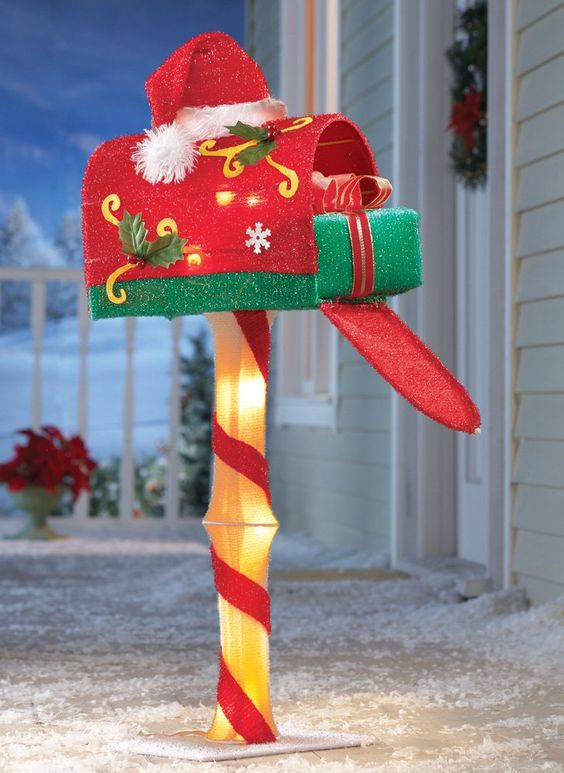 This Christmas mailbox is cute, festive, and sparkling, topped with a Santa hat