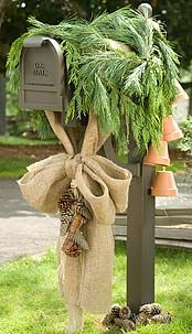 This simple Christmas mailbox is subtle with a burlap bow and some fresh green balsam branches
