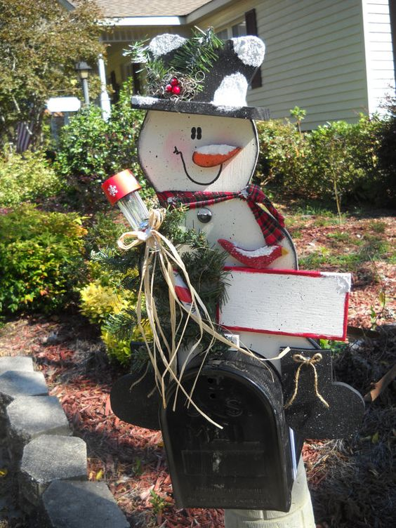 This Christmas mailbox has a gorgeous wooden snowman decked out for the Christmas season
