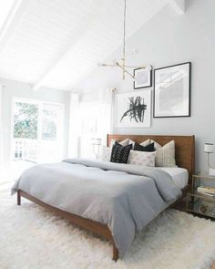 This cozy neutral master bedroom is so welcoming and warm. I love the area run, which gives the room a bit of texture