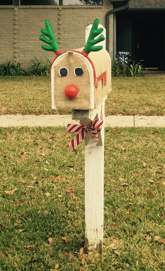 You can DIY this Christmas Mailbox to look like a reindeer with some burlap, and red nose, and a reindeer antler headband