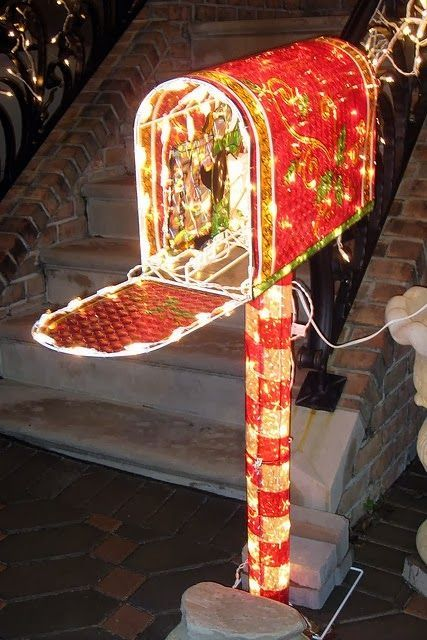 This Christmas mailbox will light up your whole front yard! It's bright red and white Christmas lights make a big statement