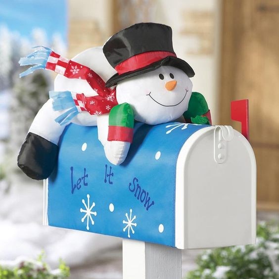 This Christmas mailbox has a cute stuffed snowman and a let it snow banner to make it festive and fun