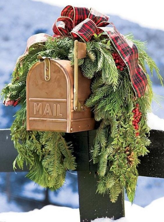 This Christmas mailbox is decked out with plaid ribbon and gorgeous full pine tree firs