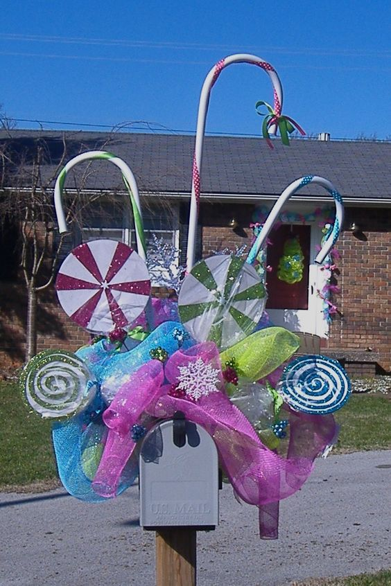 This whimsical and colorful Christmas mailbox is straight out of Candyland with lollipops and colorful candy canes