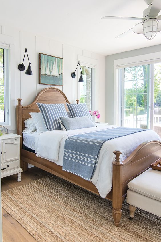 This cottage style master bedroom is cozy and inviting, it feels like you're right on the beach!