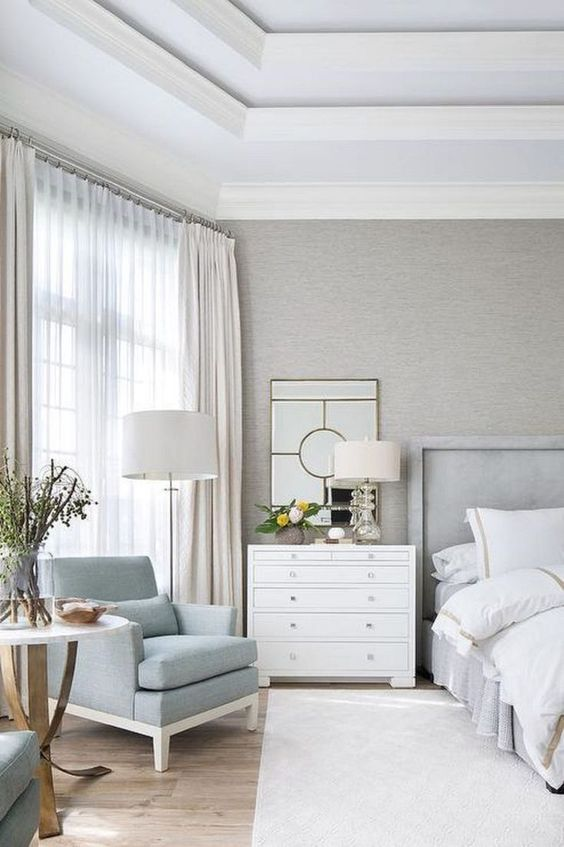 This crisp and clean bedroom has a very modern feel with sharp corners and bright colors
