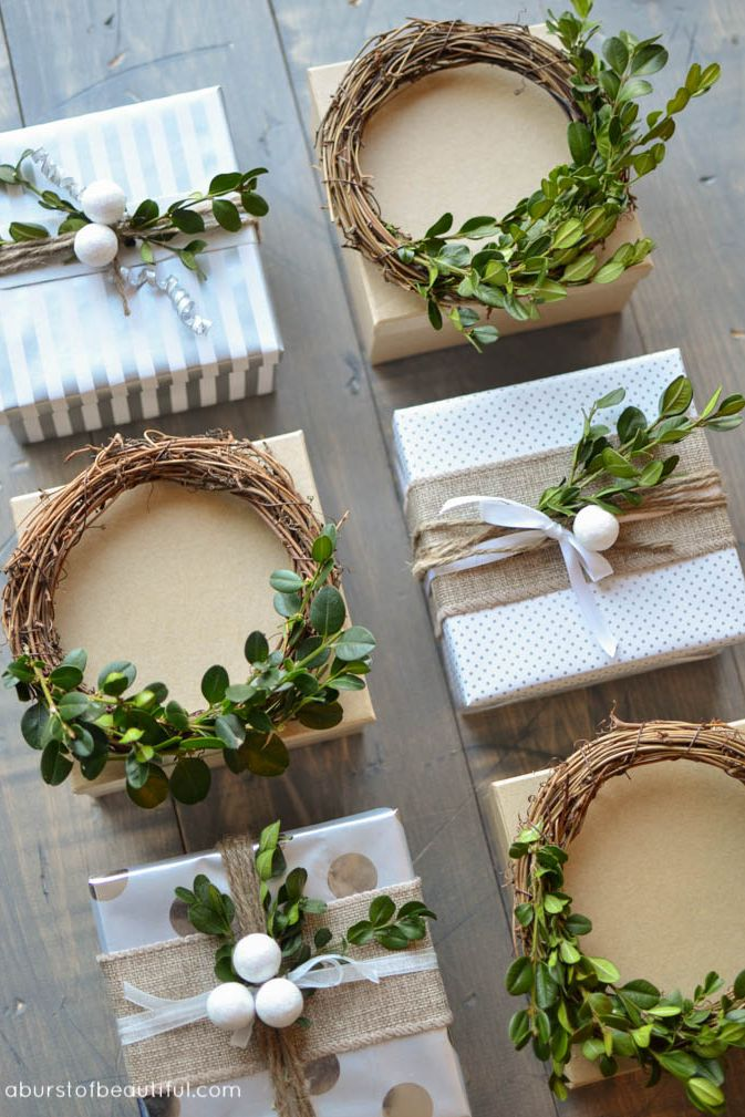 This gift wrapping is so pretty with simple-patterned wrapping paper accented with decorative rustic wreaths