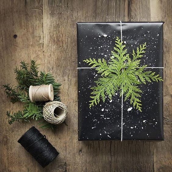 Some white twine and pine tree branches give this simple black gift wrap the perfect holiday touch
