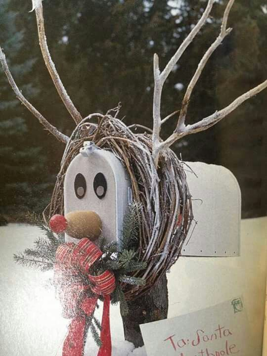 This Christmas mailbox is decorated like a snowy reindeer complete with wooden antlers