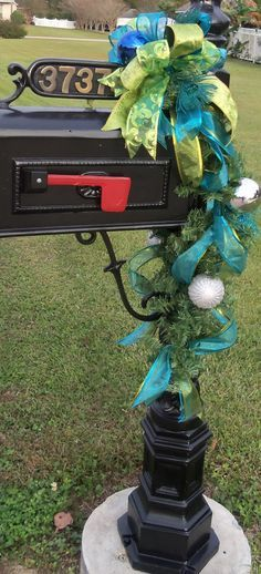 This gold and blue Christmas mailbox is subtle and simple with ribbons and ornaments