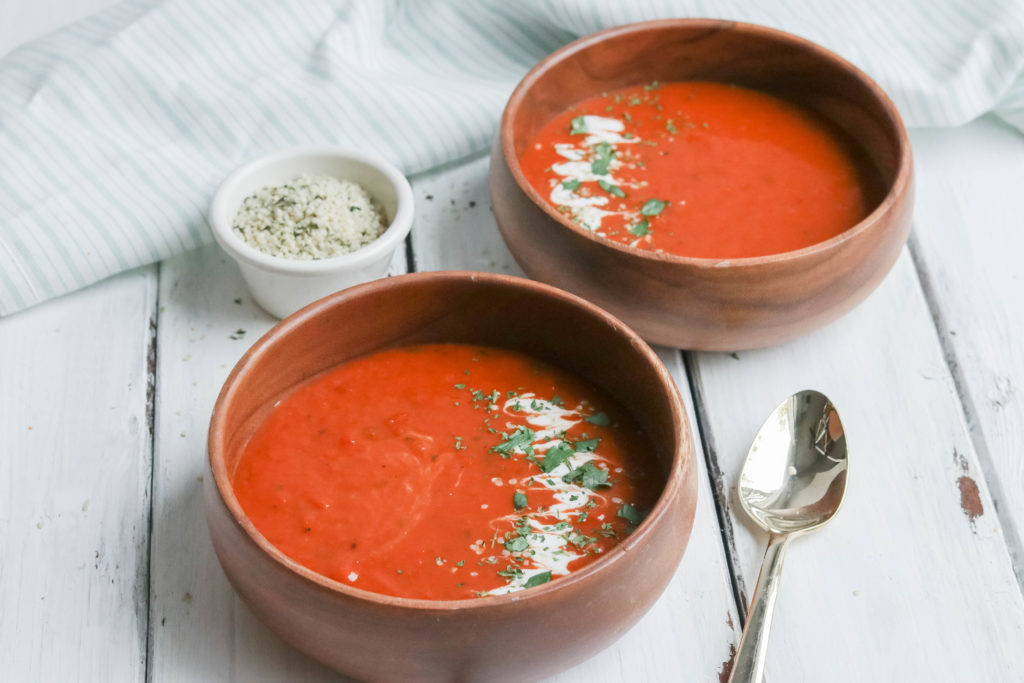 This fire roasted sweet potato and tomato soup is hearty and creamy
