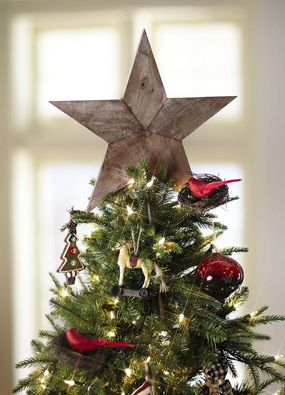 The tree topper is the shining star of Christmas tree decor! I love this rustic wood tree star